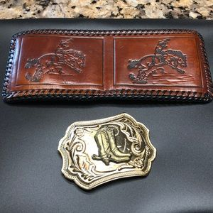 Leather billfold and belt buckle.